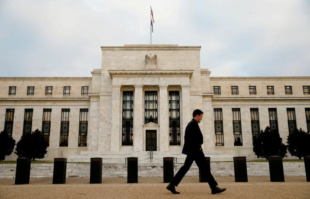A man walks past the Federal Reserve Bank in Washington, D.C., US. (Image: Reuters)
