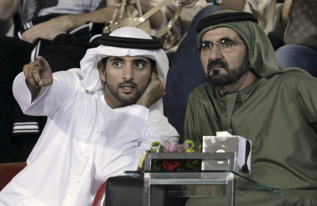 Dubai's Crown Prince Sheikh Hamdan bin Mohammed bin Rashid Al Maktoum (L) speaks to his father Sheikh Mohammed Bin Rashid Al Maktoum, ruler of Dubai and vice-president of the UAE, during the men's singles final match between Roger Federer of Switzerland and Andy Murray of Britain at the Dubai Tennis Championships. (Image: Reuters)